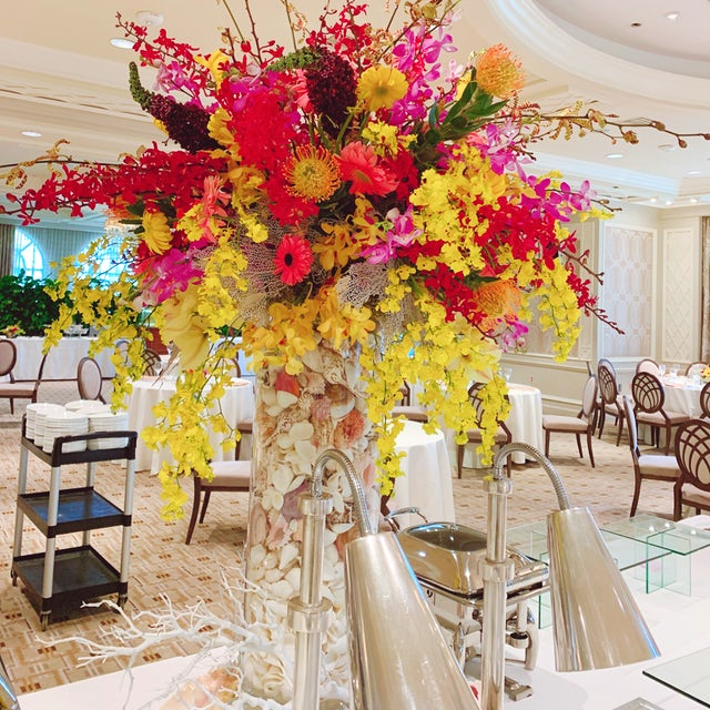 Tall Rainbow Floral Arrangement using Red Orchids, Pink Orchids, and Yellow Orchids Velene's Floral