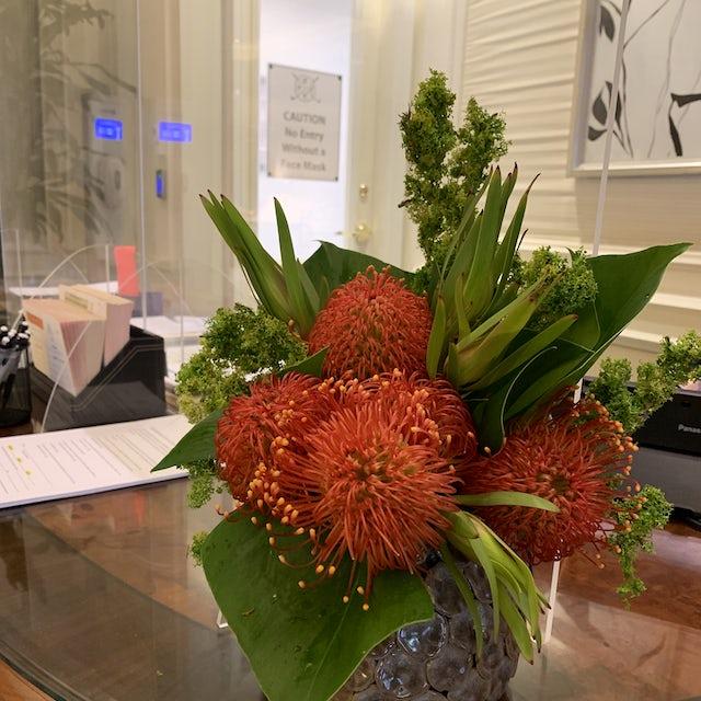 Orange Front Desk Arrangement Velene's Floral