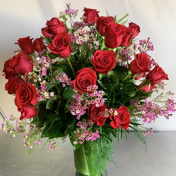 Tons of Roses with touches of Baby Breath Velene's Floral