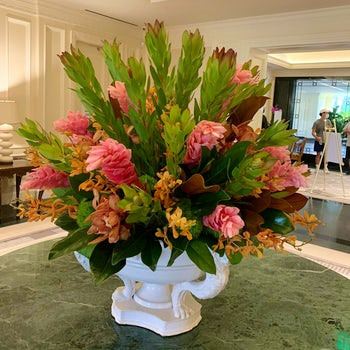 Orange Orchids paired with Pink Gingers Velene's Floral