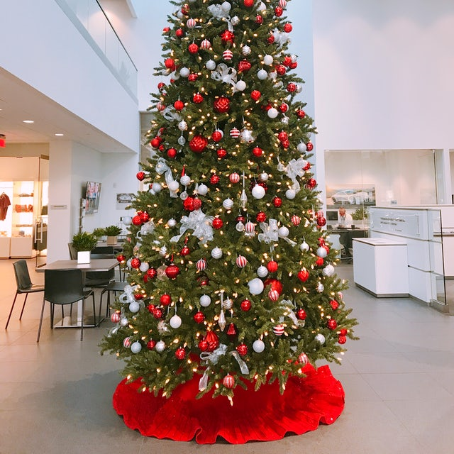 Large Christmas Tree at Car Dealership Velene's Floral