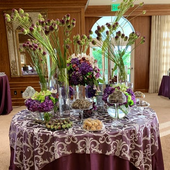 Purple Floral Setting for Event Velene's Floral